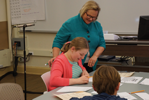 Peggy Schaefer Whitby helps a student with ASD in math word problem solving.